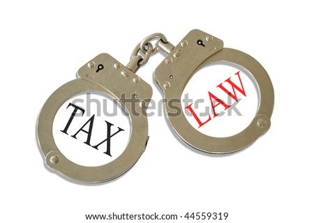 Silver metal handcuffs tax law concept - stock photo