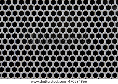 Silver metal shaped like a honeycomb for design background.