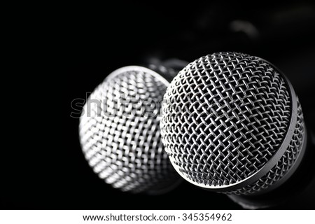 Silver microphone on the stage before the show. - stock photo