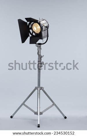 Silver Movie Studio Light on a Metal Stand isolated on Grey Background