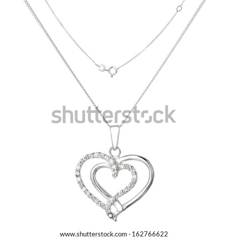 Silver necklace and pendant in the shape of heart - stock photo