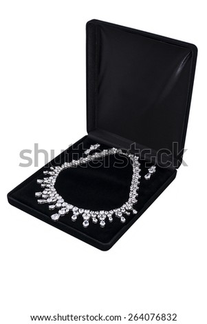 Silver necklace in black gift box on white background - stock photo
