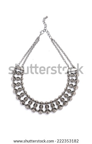 silver necklace studded on a white background - stock photo