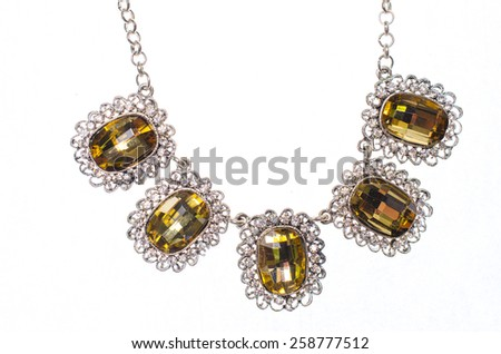Silver necklace with amber on a white background - stock photo