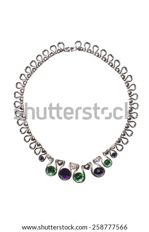 Silver necklace with colored gems on a white background - stock photo