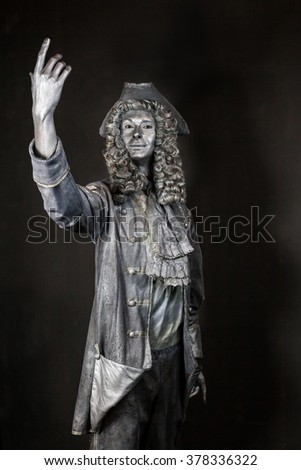 silver old dressed live statue in a wig