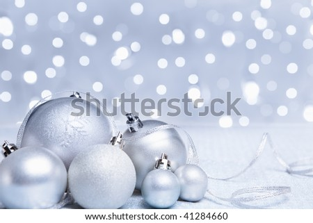 Silver or white Christmas ornament with blur light on background