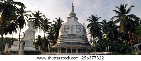Silver Pagoda and meditating buddha statue in Galle, Sri Lanka - stock photo