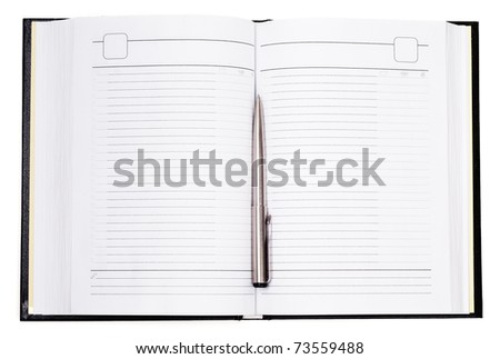Silver pan laying on the opened notepad - stock photo