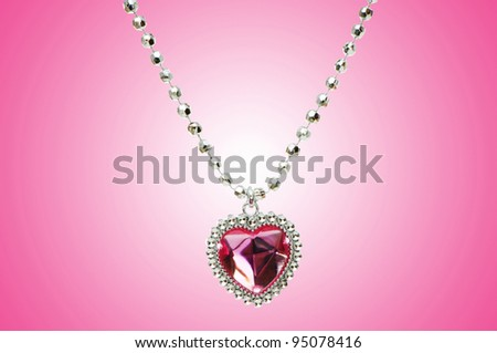 Silver pendant against gradient background - stock photo