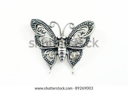 Silver pendant (butterfly shape) on a white background - stock photo