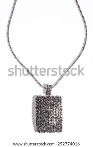 silver pendant on a white background - stock photo