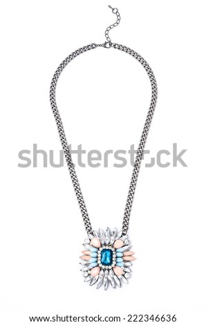 silver pendant with flower on a white background - stock photo