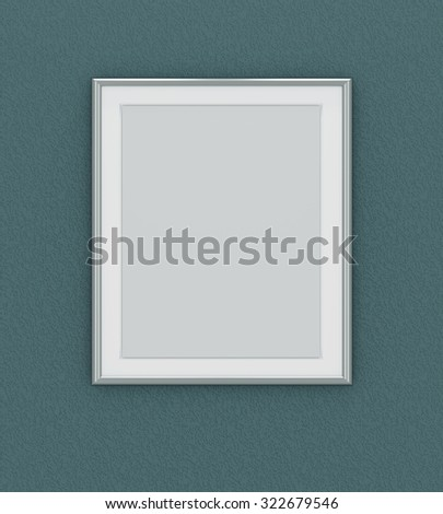 Silver picture frame over dark green wall - stock photo