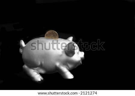 Silver piggy bank over black background with one dollar - stock photo