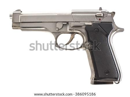 Silver pistol left side - stock photo