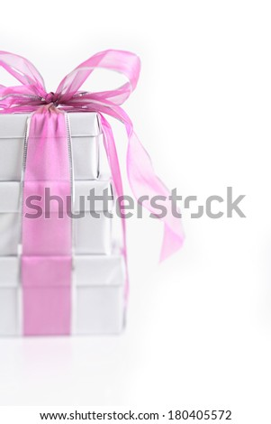 Silver presents with pink bow on white background  - stock photo