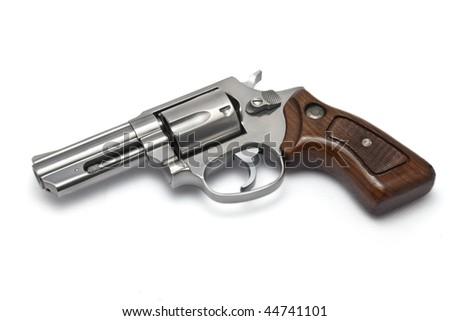 Silver revolver on white background - stock photo