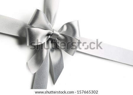 Silver ribbon bow isolated on white background - stock photo