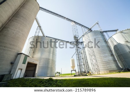 Silver, shiny agricultural silos