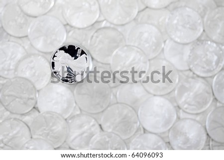 Silver shiny one dollar coin isolated on blurred money background - stock photo