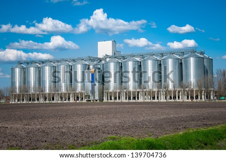 Silver silo - stock photo
