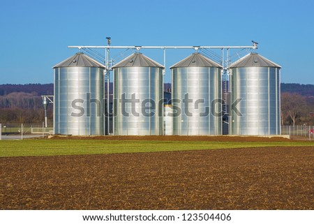 silver silo in rural landscape - stock photo