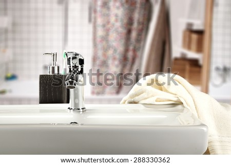 silver sink and white towel in bathroom  - stock photo
