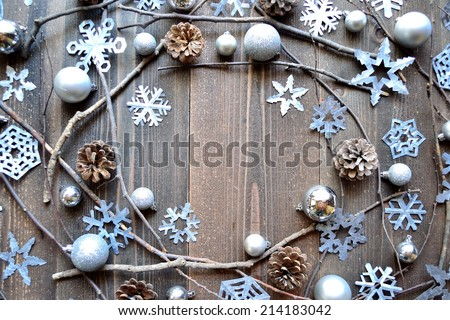 Silver snow flakes with pine cones.Image of Christmas and winter season. - stock photo