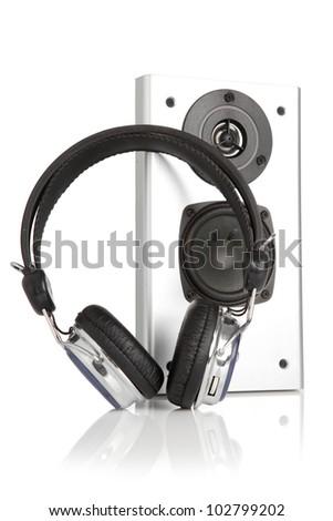 Silver sound speaker and headphones - stock photo