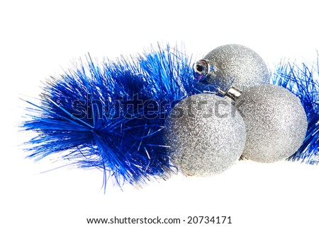 Silver spangled Christmas balls and blue tinsel - stock photo