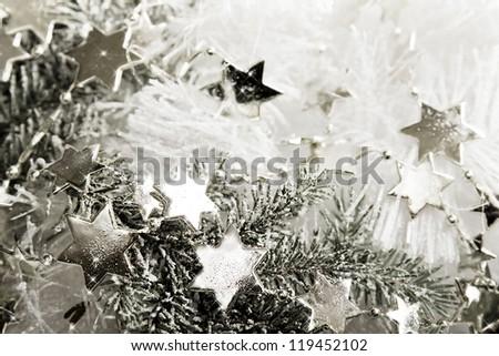 Silver sparkling stars on a white glistening background - stock photo