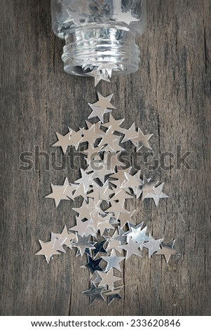 silver stars for christmas on a old wooden background - stock photo