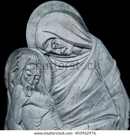 silver statue of Virgin Mary with  Jesus Christ in her arms (Crucifixion, pain, death, resurrection) - stock photo