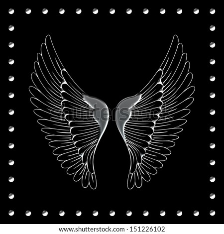 Silver studded black background with silver wings - stock photo