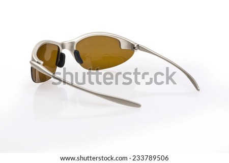 silver sun glasses on white background - stock photo