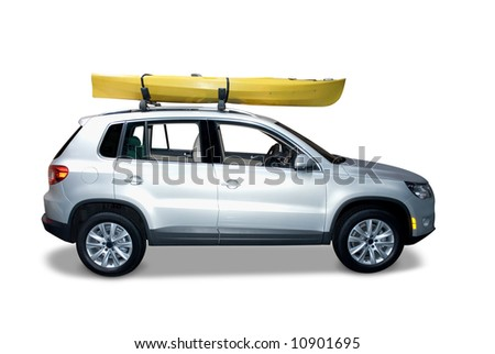 Silver suv with a Kayak on top. Isolated on a white background with a shadow detail drawn in under the car. Clipping path for the car and Kayak is included. - stock photo