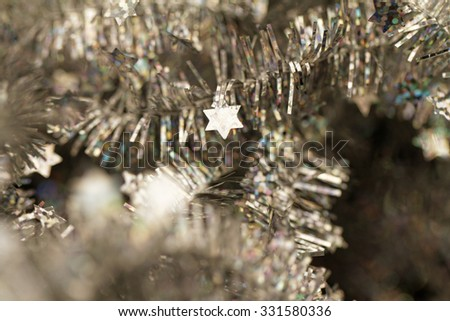 Silver tinsel Christmas decoration - close-up photo - stock photo