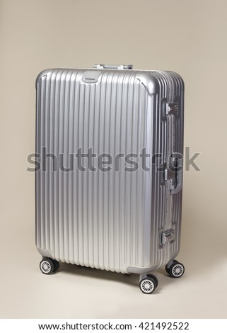 Silver trolley suitcase luggage - stock photo
