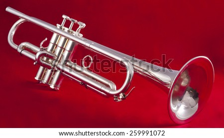 silver trumpet on red background