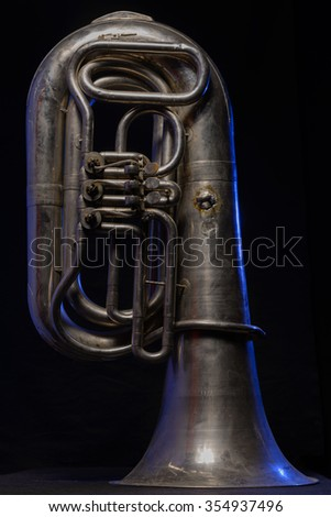 silver tuba isolated on black background - stock photo