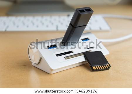 silver usb 3.0 extender with universal memory card slots hub, SD card, mini SD card, CF card - stock photo