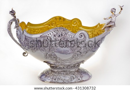 silver vase on a white background, Close up photo of handmade silverware that is delicately handcrafted, Custom made authentic designs are the key factor in getting the fine art made. - stock photo