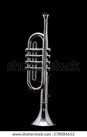 Silver Vintage Toy Trumpet on a Black Background - stock photo