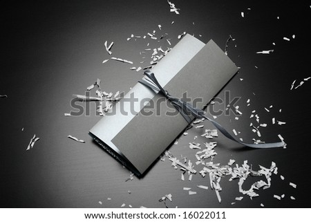 silver wedding invitation envelope on the black table with decor - stock photo