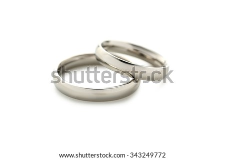 Silver wedding rings isolated on a white - stock photo