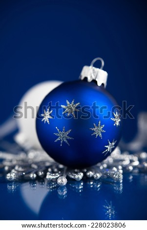 Silver, white and blue christmas ornaments on dark blue background with space for text. Merry christmas card. Winter holidays. Xmas theme. - stock photo
