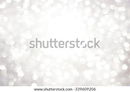 Silver white glittering Christmas lights. Blurred abstract background - stock photo