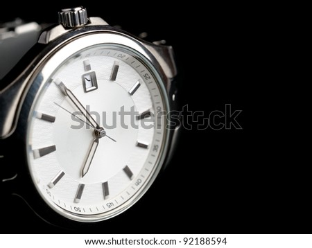 Silver wrist watch isolated on black background - stock photo