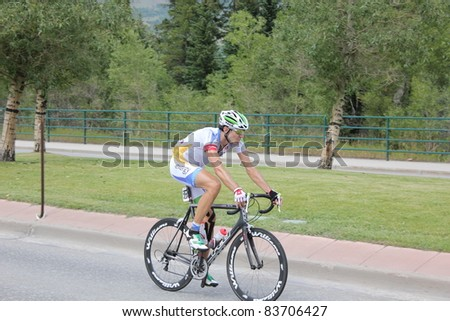 SILVERTHORNE, CO - AUGUST 27:An unidentified USA PRO Cycling Challenge Stage 5 cyclist rides from Steamboat Springs to Breckenridge, Colorado, August 27, 2011 in Silverthorne, CO. - stock photo